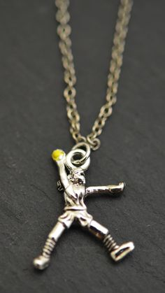 Our softball pitch pendant is a great gift idea for your team's star softball pitcher! It is shown here on a silver link chain but feel free to choose any of our 4 options!