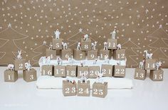 Advent calendar - white painted animal figurines with adorable red noses…