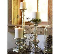 Create a dramatic display of silver and candlelight. Our elongated pillar holders have a sculptural design that mixes the classic turnings of woodwork with a square base and seamless stainless steel top. Mercury Glass Candle Holders, Gold Candle Holders, Candlestick Holders, Candle Sconces, Candleholders, Christmas Candles, Christmas Decorations, Silver Candlesticks, Pottery Barn