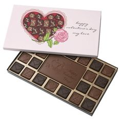Pretty Happy Valentines Day My Love Chocolate Box filled with45 delicious Belgian chocolates in your choice of milk, dark or assorted flavors that are engraved with Valentine's Day symbols of your love..
