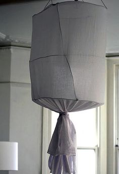 lamp cover but I think I would use large hoops already available for a neater appearance, fishing line to string them together and then cover with material...