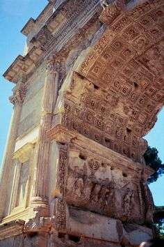 Arch of Titus. Coffers above and a relief panel of the Spoils of Jerusalem. Opposite side is a relief of the Triumph of Titus. Evil man, beautiful arch...