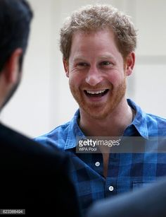 Prince Harry jokes with staff before he watches a rehearsal of the 'Joyful Noise' choir a creation of NAZ a sexual health charity. Nov. 15, 2016