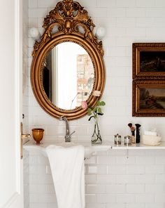 love the subway tiles and gold baroque mirror