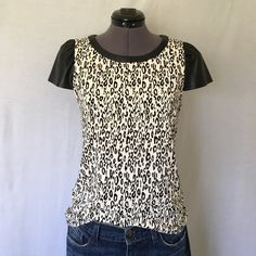 """Ella Moss """"Frankie"""" Faux Leather Sleeve Top Adorable!!   NWOT. """"A graphic leopard print & supple faux-leather trim cast a modern spell on a classic princess-sleeve top. Back keyhole with button-and-loop closure."""" -EM  Has bust darts and a center back seam. Back of neck to hem is 22.5 inches, bust measured flat across is 16.5 inches. Size Small, TTS. 95% viscose, 5% spandex. Faux-leather is 100% polyurethane. NWOT, Never worn, in Perfect Condition! Ella Moss Tops"""