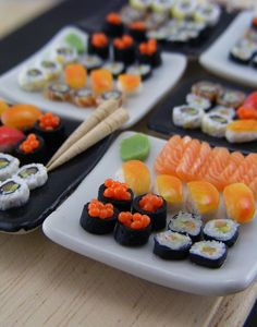 I own quit a few earring pairs featuring tiny food made by this artist. His work is AMAZING! Sushi Weekend #2 by Shay Aaron, via Flickr