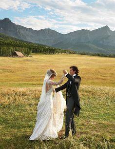 Couple: Lauren Bush & David Lauren.   This amazing dress was designed by Ralph Lauren (her new father-in-law).
