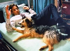 David and Dog from The X-Files Flashback! See Vintage Behind-the-Scenes Photos  David Duchovny hangs out with a canine friend.