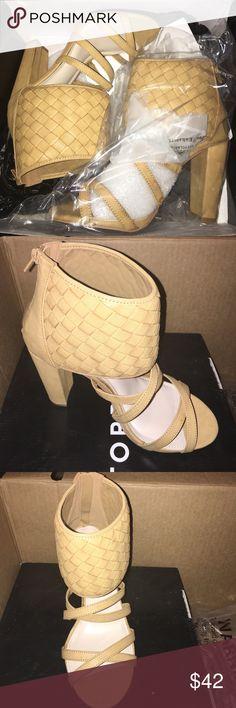 New TORRID Tan zip up heel sandals size 10w Super cute!!!! Tan strappy heels. Zip up backing cross cross ankle design. Size 10w torrid Shoes Heels