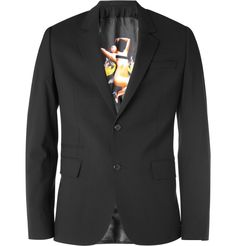 A pin up-lined blazer by Givenchy.  Always good to have one of these in the closet, both collar down or collar up.
