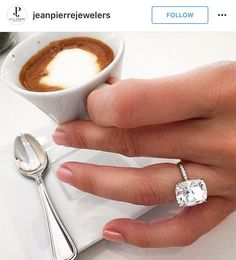 DREAM RING ❤️❤️ elongated cushion cut on micopave diamond 18k white gold band . I like the look of the stone floating
