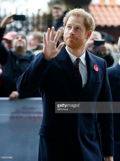 Prince Harry, Vice Patron of the Rugby Football Union, waves to the crowd as he arrives ahead of the the Old Mutual Wealth Series match between England and South Africa at Twickenham Stadium on November 12, 2016 in London, England.