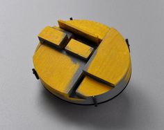 By Julia Turner, Stack Brooch (Yellow), Maple, stain,paint, steel.