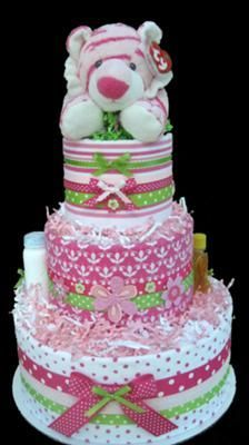 Pink Pop Tiger Blanket Diaper Cake: Pink Pop Tiger Blanket Diaper Cake Instructions  Each tier of this diaper cake is wrapped in a pressed Amy Coe receiving blanket and then tied off around