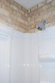 Tile above the shower insert.