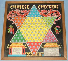 Chinese Checkers - HEY! We had one of these, looked exactly like this. It was not mine - it was the adults. Noone played it much, and not me, as I was an only child and you need more than 1 to play.