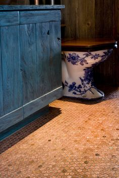 Love this vintage french handpainted toilet.  Awesome color palette in this powder room.Penny Floor Installation by Alpentile, www.alpentile.com.  Design/Build by Red Rock Contractors.