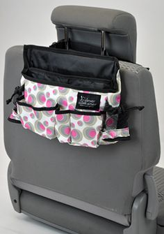 Who couldn't use a little extra space in their car? Swing this carrier to the front side of the passenger seat for those who need an office on the go! Has one large file pocket for papers, magazines and folders, five pockets for cell phones, PDA, glasses, CDs, etc., and two mesh side pockets for drinks, wipes, mints, etc. $28 www.mycleverbiz.com/nicole