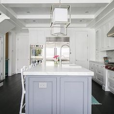 White Cabinets with Gray Center Island