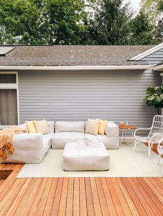 sharing the reveal of our backyard deck design with Article - family friendly decor and a minimal aesthetic  backyard deck design with Article