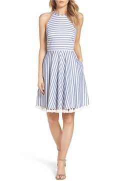 Pom poms & stripes liven up this garden party ready fit and flare dress.
