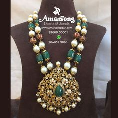 Gorgeous in green! Beauty and royalty comes together in this combination tar mala. Beautiful long haaram with floral design large pendant. Pendant with pearl hangings. Get in touch with Amarson to own this masterpiece! Beaded Jewelry Designs, Gold Earrings Designs, Gold Jewellery Design, Bead Jewellery, Jewelry Patterns, Necklace Designs, Indian Wedding Jewelry, Bridal Jewelry, Emerald Jewelry