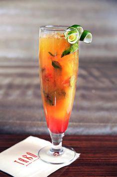 Peach Kiss - Absolut Peach Vodka, Fresh Lime Juice, Simple syrup, Peach Puree and Fresh Mint