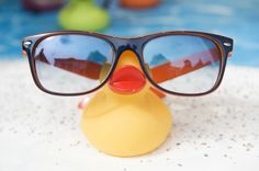 Rubber ducky as a frame holder.  Would be very cute for children frames.