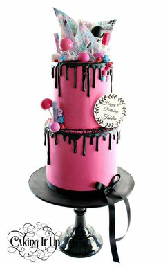 Beautiful cake. Pink and black candy accents. Photo from Artisan Cake Company