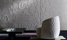 Tackle accoustic problems with padded wall coverings from Elitis