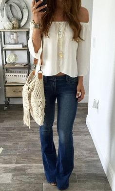 white off shoulders top + flared jeans.