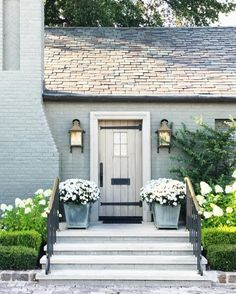 light blue gray brick and large planters