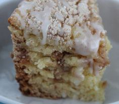 This Two-Hour Slow Cooker Cinnamon Coffee Cake is an easy coffee cake recipe that incorporates Bisquick, cinnamon, sugar, and more.