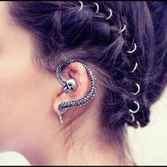 Skull and spine wraparound ear decoration.