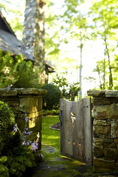 Pretty low stone wall and garden gate. Would love to have a walled-in veggie garden at the new place. Maybe we could make one out of cob with a cob pizza oven too. Dream Garden, Home And Garden, Garden Cottage, Jardin Decor, Photo Blue, Fence Gate, Porch Gate, Fencing, Garden Gates