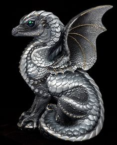 Google Image Result for http://windstoneeditions.com/sites/default/files/imagecache/product_full/spectral-dragon-silver-514-S.jpg