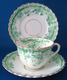 In honor of St. Patrick's Day still...here is an antique Staffordshire teacup trio in a grass green transferware floral pattern. The set was made in the 1870-1890 and I think it's lovely! The set is unmarked, which was quite normal prior to 1891 when potteries were required by law to mark country of origin on their items.  I'd call it shamrock green!
