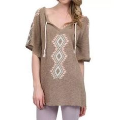 FREE PEOPLE Top Patterned Swing Tunic Sweater Mini Available Sizes: P/S and M/L. New with tags.  $248 Retail + Tax.   • Gorgeous bohemian eyelet knit marled tunic top featuring braided tassel ties & front slit at neck.  • Semi-stretchy ribbed hems; 100% cotton.  • By Eternal Sunshine Creations for Free People.  • Measurements provided in comment(s) section below.   {Southern Girl Fashion - Closet Policy}   ✔️ Same-Business-Day Shipping (10am CT). ✔️ Reasonable best offer considered when…