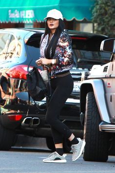 Kylie Jenner wearing givenchy bomber jacket and yeezy boots | LookLive