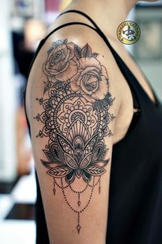 Mandala tattoo by Tadashi . Not on the shoulder but on the thigh and with peonies instead she of roses