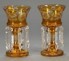 lighting, Germany, A pair of overlay glass mantel lustres, Germany, dark amber cut-to-clear etched bird and landscape designs, each with prism drops. circa 1801-1900