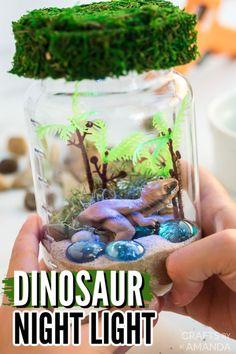Kids love dinosaurs, so putting together this fun mason jar dinosaur nightlight will be an especially fun project they can make! #nightlight #kidscrafts #dinosaurs #giftideas #craftsbyamanda Diy Projects For Kids, Diy Crafts For Kids, Craft Ideas, Craft Projects, Art Games For Kids, Dinosaur Light, Crafts From Recycled Materials, I Love Diy, Rainy Day Crafts
