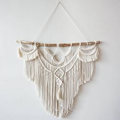 Large Macrame Wall hanging  A fusion knots and of course lots of fringing! The star of this piece is a beautiful long branch.  Your piece is made by hand using natural unbleached cotton and revived branches from local woods in Upstate NY and the Adirondacks. ✨✨✨  SIZING She measures roughly 30in x 27in (including the branch) so she is sure to stand out wherever you choose to hang her.  Sizing is approximate: Branch Width - 30 Macrame Length - 27 Rope hanger- 15 (adjustable)  ✨✨✨  MADE TO…