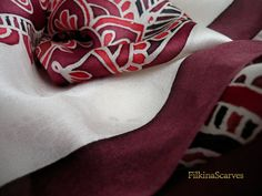 Mandala red Hand Painted Silk Scarf Batik Silk by FilkinaScarvesAn elegant luxurious Mandala Silk Satin Chiffon scarf with red, dark red, Bordeaux and black mandala ornaments lined with dark Bordeaux color stripe on white (ìvory) background.  The fabric is 100% Natural Silk Satin Chiffon - one of the most Luxurious fabrics - exceptionally gentle, vivid and soft to touch  Silk Satin Chiffon is a delightful light weight soft to touch semi-sheer chiffon silk with an elegant satin finish on one…