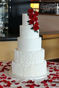 White 5 tier cake with red roses. Dolce and Gabbana lace inspiration with Oscar de la Renta ruffles by Sugared Saffron.