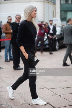 Sarah Harris of Vogue UK enters Ferragamo in a Balmain jumper, Gucci trousers, and Adidas Stan Smith sneakers on Day 5 of Milan Fashion Week FW15 on March 1, 2015 in Milan, Italy.