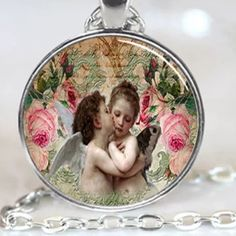 CHERUBS Silver tone chain. About 20 inches. Chain length approx. medallion about an inch. alloy and glass. No trades. Thank you Jewelry Necklaces