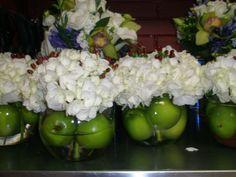 Cool fall centerpiece - green apples in the base, white hydrangea, & seasonal berries