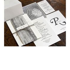 Brides.com: . A beautifully detailed illustration of tree growth rings and elegant typography combine to create this fall-inspired suite. Custom design by Perky Bros.; printed by Studio on Fire