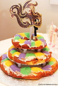 """And again from the """"Pretty in Pink"""" baby shower - while we did have a traditional cake, we also had a 3 tier king cake - and ode to our New Orleans roots and one of my cravings at the time :-)  The mask is actually the hubby's mask he wore at our Mardi Gras themed wedding reception"""